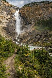 The Rocky Mountains. Majestic Takakkaw Falls Waterfall On Rock Face And Takakkaw Stream   In Yoho Na