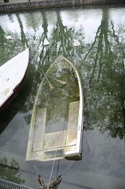 Drowned Small Boat And Paddles In Annecy Thiou River