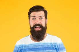 Hair Care And Beard Grooming. Handsome Confident Man Has Perfect Hairstyle. Male Facial Care. Portra
