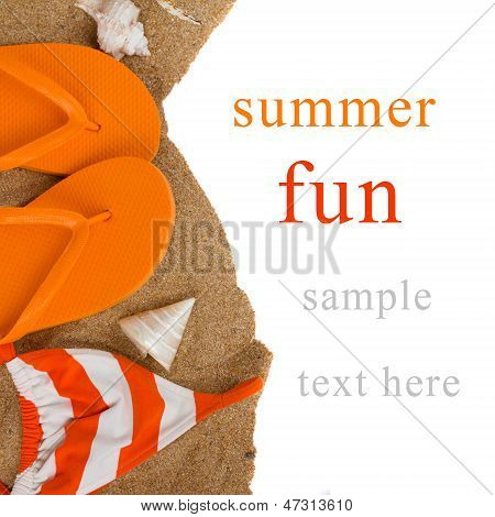 orange flip flops and swimming suit on sand