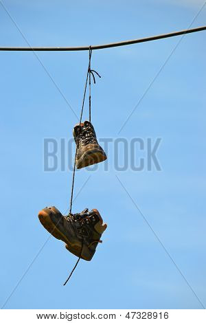 old shoes hanging on a power cable