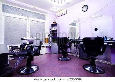 Armchairs in hairdressing salon interior in blue colours poster