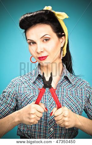 Girl In Check Shirt With Pliers