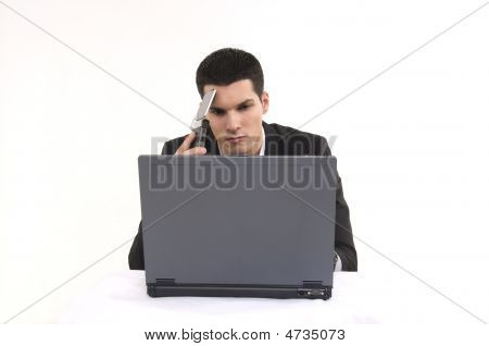 Businessman With Lap Top Computer And Phone.