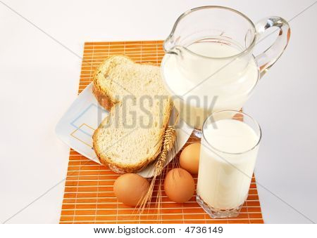 Pitcher Of Milk, Wheat, Bread And Eggs.