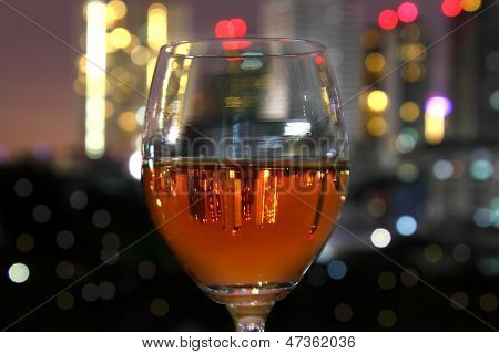 Wine Glass And City Reflex