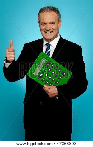 Businessman Showing Thumbs Up, Holding Calculator