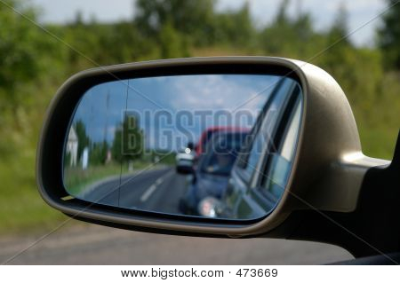 traffic & queue in rear view mirror poster