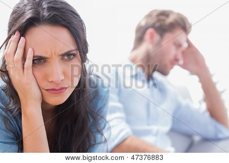 Irritated woman holding her head in the living room
