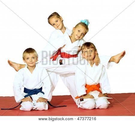 Four athletes in a kimono on a white background
