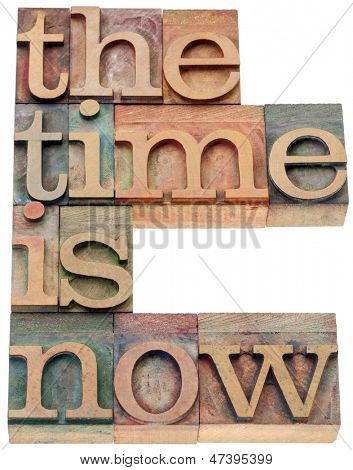 the time is now - motivational concept - isolated text in letterpress wood type