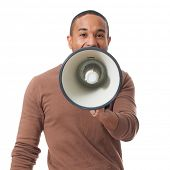 Young Man Shouting Through Megaphone Over White Background poster