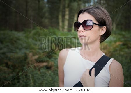 Shot Of A Beautiful Brunette Lady Out For A Walk In The Forest