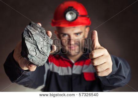 Coalminer With Lump Of Coal