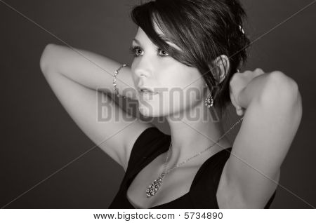 Stunning Teenage Model Putting On Her Necklace