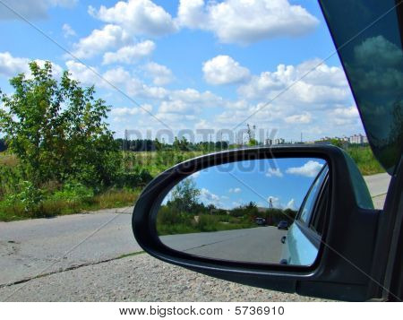 Reflection in a car mirror
