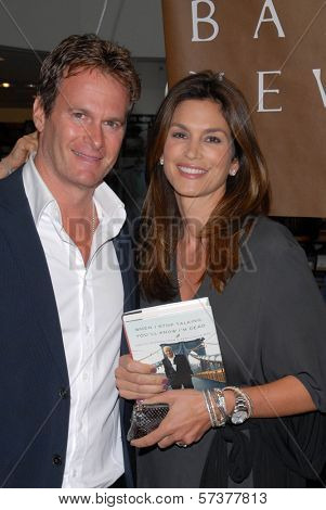 Rande Gerber and Cindy Crawford at a celebration of Jerry Weintraub's New Book