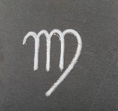 The zodiacial sign of virgo drawn with chalk on a plate of slate. poster