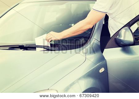transportation and vehicle concept - parking ticket on car windscreen