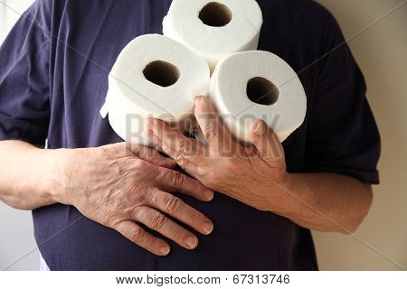 Man with hand over stomach and toilet paper