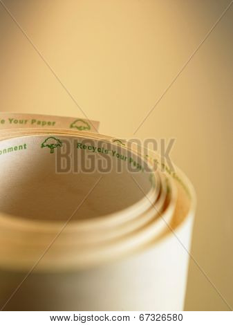 rolled up recycle adding machine tape