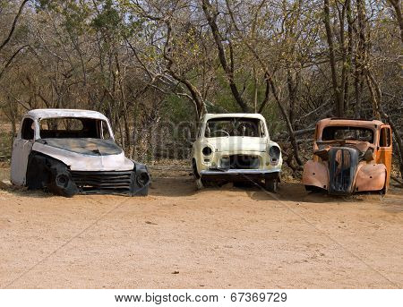 Three Old Wrecked Motor Vehicles