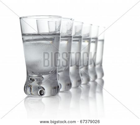 Many Glasses Of Vodka Isolated On White Background