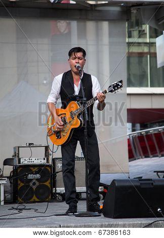 Derek Miller Performing At Yonge Dundas Square In Toronto