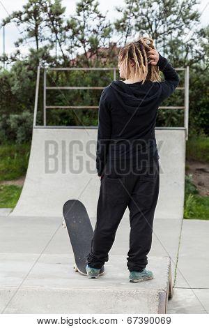 Girl With Dreadlocks And A Skateboard