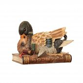 Duck moneybox with the book and cartridges on a white background poster