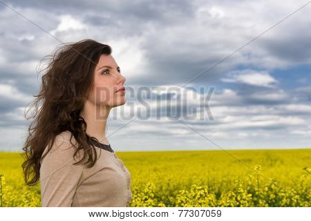 woman portrait in yellow flower field