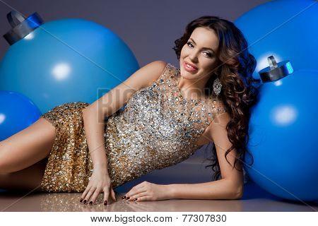 Woman with blue Christmas balls