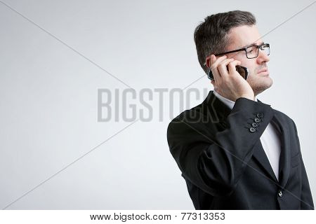 Business Man phoning With A Mobile