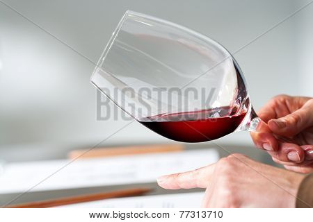 Hands Testing Wine Density At Tasting.