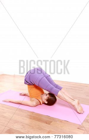 young Japanese woman doing YOGA