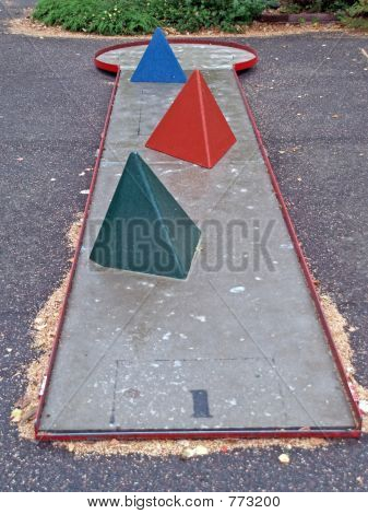 Mini golf playing field with pyramids