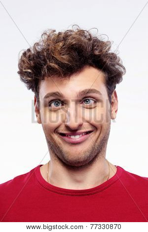 Portrait of a young man with funny expression on his face