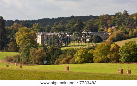 A view over English countryside on a bright afternoon in early autumn with stately house in the background. Photo taken near to Compton Verney Warwickshire. poster