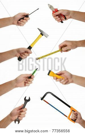 Male hands with lots of house improvement tools isolated on white