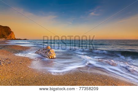 Serene South Dorset Beach And Sea At Sunset