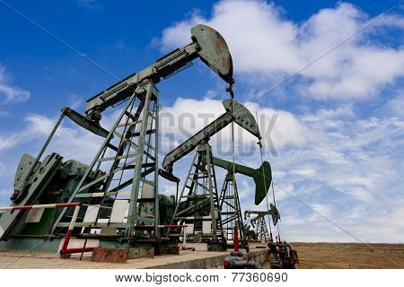 Working oil pump jacks on a oil field