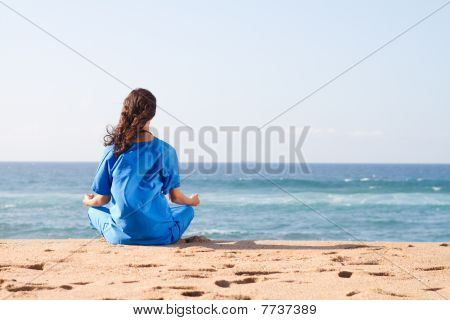 nurse meditating on beach