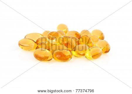 Vitamin E supplement capsules closeup on a white background poster