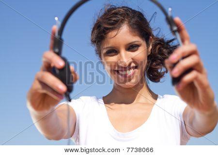 beautiful woman holding earphones