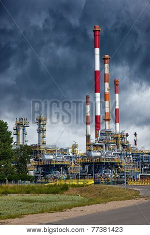 Refinery Under Dramatic Sky