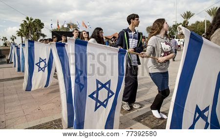 BNEI AKIVA youth group ceremony rehearsal with Israeli flags