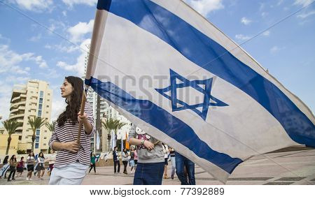 youth group ceremony rehearsal with Israeli flags