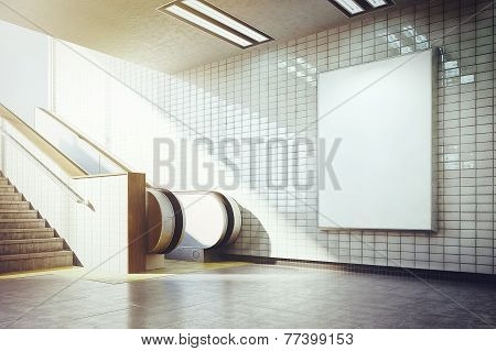 big vertical blank billboard with escalator