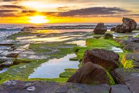 Sunrise Over Green Rocks