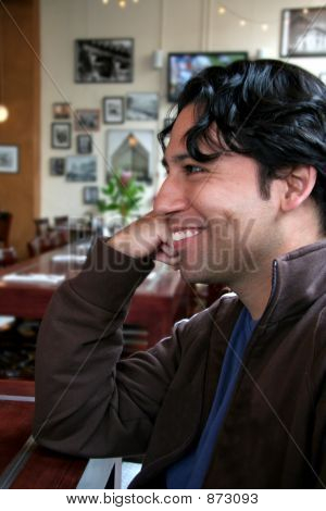 Hispanic Man In Restaurant, Smiling And Talking